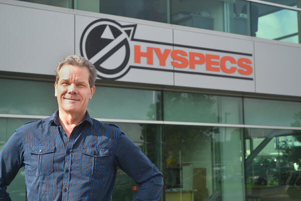 Richard in front of Hyspecs Sign - Raw